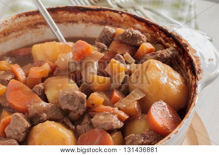 Hearty meat and vegetable stew a traditional dish containing meat gravy potatoes turnips onions and carrots