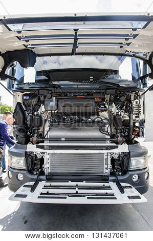 KIEV,UKRAINE - May,21: Details of the engine of the truck Scania G400 with open hood during celebration of 125 anniversary of Scania company in Kiev,Ukraine May 21,2016.