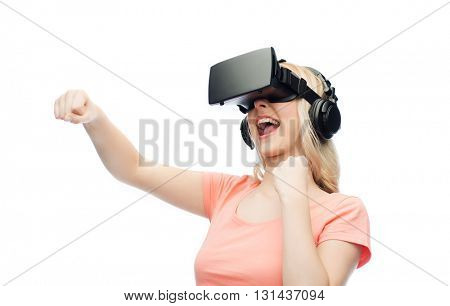 3d technology, virtual reality, entertainment and people concept - happy young woman with virtual reality headset or 3d glasses playing game and fighting
