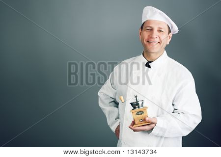 Portrait of an aged professional male cook. Shot in a studio.