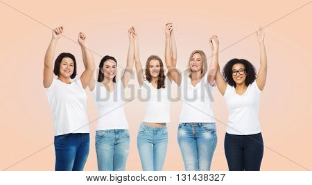 friendship, diverse, body positive and people concept - group of happy different size women in white t-shirts holding hands up over beige background