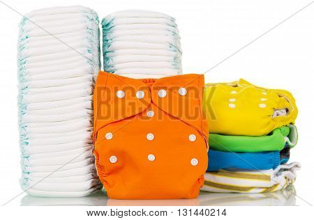 Pile cloth and disposable diapers isolated on white background.