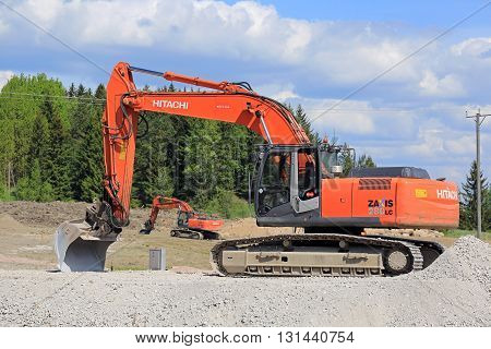 VIHTI, FINLAND - MAY 21, 2016: Hitachi Zaxis 280 LC crawler excavator by a construction site in South of Finland. The 280 LC has an operating weight of 286 t.
