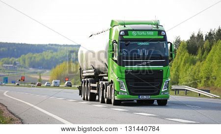 SALO, FINLAND - MAY 13, 2016: Lime green Volvo FH 500 semi tank truck drives along motorway in South of Finland on a spring evening.