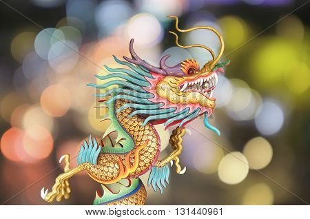 Chinese dragon with colorful golden bokeh background