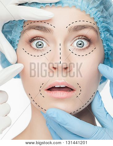 The beautiful surprised woman face with lines before plastic surgery operation of cosmetology