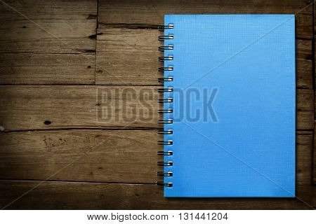 Blue sky note book on wooden background