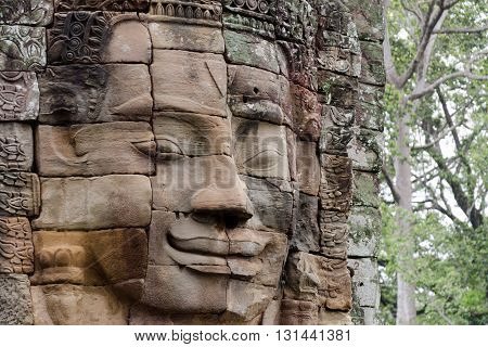 Stone face in Bayon Temple at Angkor Wat complex in Siem Reap Cambodia
