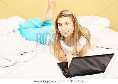 Young woman having a rest with her laptop.