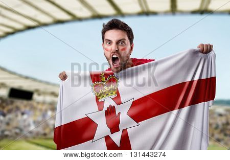Fan holding the flag of Northern Ireland