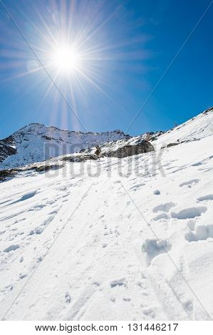 Snow trail ascneding a slope. Maltatal valley in Austria.