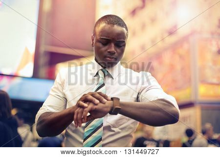 Businessman checking the time