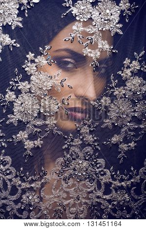 beauty young woman throw white lace close up, bride under veil, real bride brunette  tann, fashion people concept