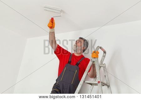 Worker Paint Wall In A Room