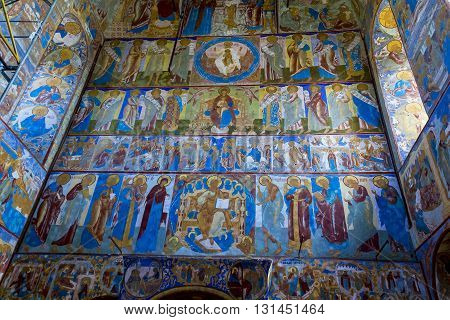 ROSTOV RUSSIA - JUNE 3 2013: Rostov Kremlin. There are frescoes on the walls of the ancient Gate Church of Icon of the Mother of God