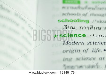 dictionary page with word science highlighted in green