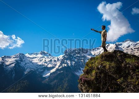 Photo Man Traveler With Mountains On Background.