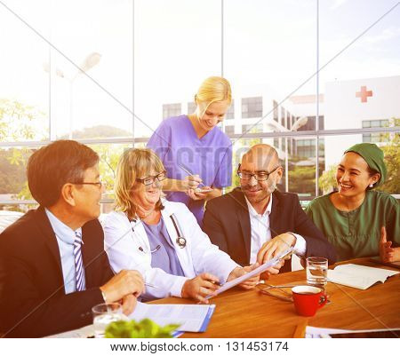 Group Of Multiethnic Group Of Doctors Having A Positive Meeting