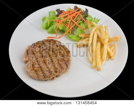 Hamburgers steak with french fries bread and Vegetable isolated on the black background with clipping path