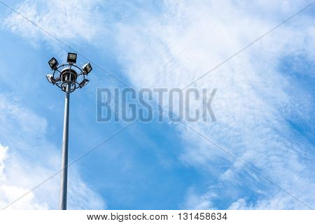 Electric light post with blue sky and clouds background with copy space