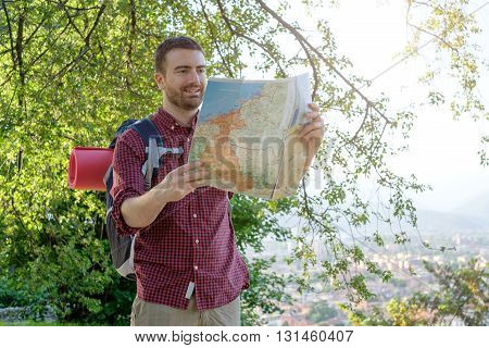 young urban traveler consulting a map to find the right path