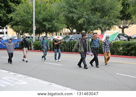 ANAHEIM CALIFORNIA, May 25, 2016: Protesters wear masks and bandanas in order to hide their identities and cause trouble for the police at the  Presidential Candidate Donald J. Trump rally 5.25.2016