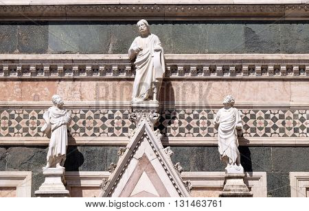 FLORENCE, ITALY - JUNE 05: Two Prophets and the Redeemer attributed to Andrea Pisano, Portal on the side-wall of Cattedrale di Santa Maria del Fiore, Florence, Italy on June 05, 2015
