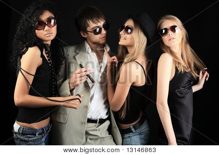 Group of a stylish young people. Fashion, beauty, entertainment.