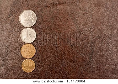 Russian Coins (rubles) Lie On A Leather Background.