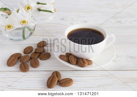 Cup Of Coffee, Cookies And Narcissus On White Wooden Background