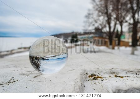 Crystal ball on the railing of the embankment of the Volga River in the city of Cheboksary.