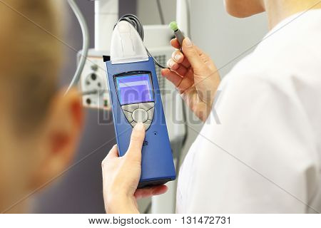 Hearing test. otolaryngologist doctor examining a patient.