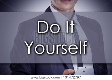 Do It Yourself - Young Businessman With Text - Business Concept