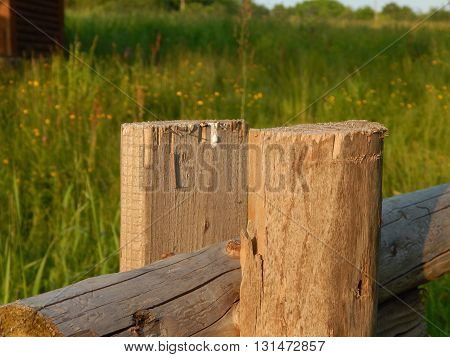 Wooden old pillar rural fence close up