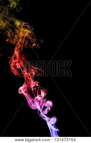 Abstract colorful smoke on black background from the incense sticks