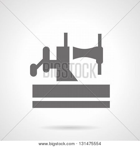 Monochrome silhouette of manual sewing machine. Obsolete household equipment, vintage mechanics. Badge for blog, hobby or studio. Symbolic black glyph style vector icon.