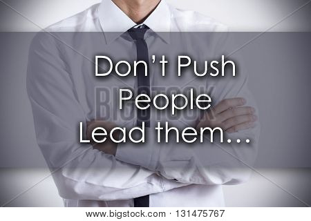 Don't Push People Lead Them… - Young Businessman With Text - Business Concept