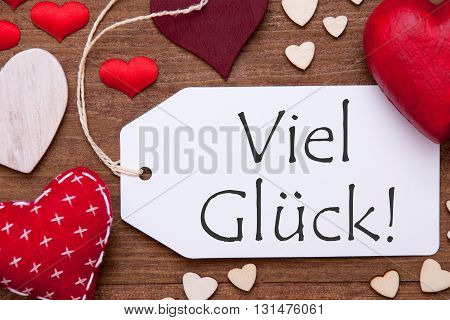 Label With Red Textile Hearts On Wooden Gray Background. German Text Alles Liebe Zum Muttertag Means Happy Mothers Day. Retro Or Vintage Style. Macro Or Close Up Of One Label