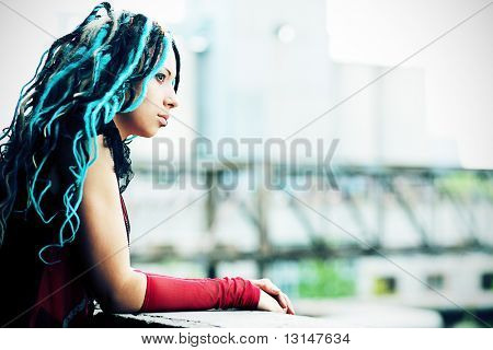 Portrait of a stylish young woman with dreadlocks.