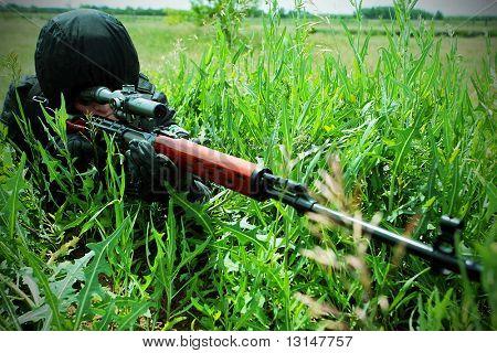 Shot of a soldier holding gun at a battlefield.