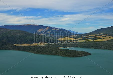 View from Mt Robert. Turquoise Lake Rotoiti and village St Arnaud. Summer scene in New Zealand.