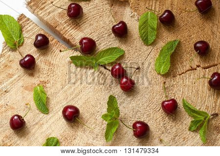 Group of cherries with water drops on the stump