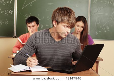 Educational theme: students in a classroom.