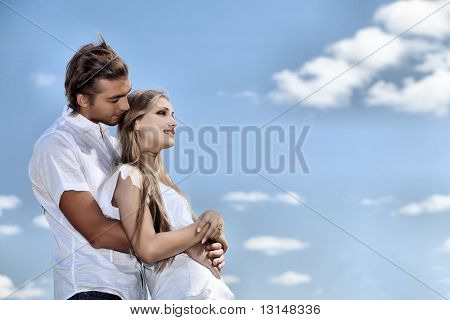 Portrait of a young couple in love outdoor.
