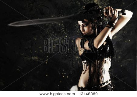 Beautiful female fighter with a sword in her hands.
