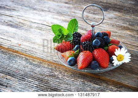 Mix Of Fresh Berries On Rustic Wooden Background