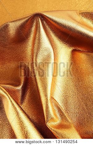 Golden leather texture close up