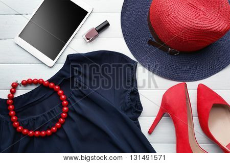 Composition of woman's fashion look on wooden background