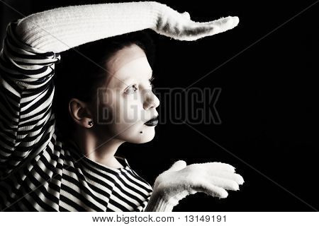 Portrait of a female mime in sailor's striped vest.