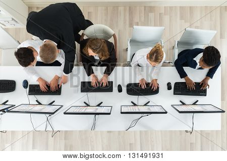 High Angle View Of Businesspeople Together Working In The Office